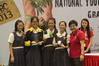 The team in all smiles after receiving their prizes on stage