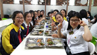 Lunch time! Girls enjoying hearty laughter and hearty meals with newfound friends